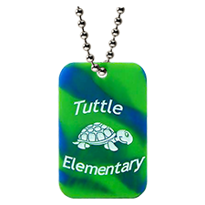 Custom silicone dog tag that is green and blue camo with the tuttle elementary school logo and turtle mascot.